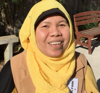 Indonesian woman with yellow head scarf