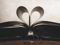 Open book with pages shaped into heart