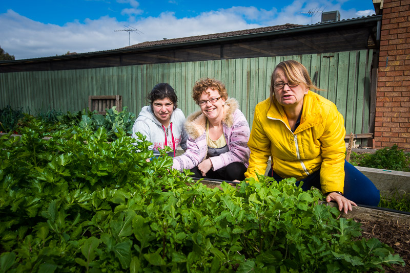 Three women in a community garden